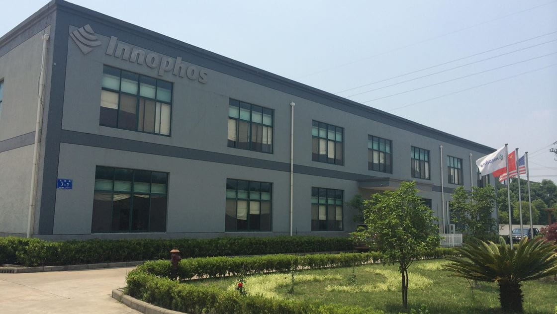 Photo of physical logo of Innophos displayed on wall.